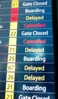 Multi-colored Airport Flight Board Showing Delays and Cancellations