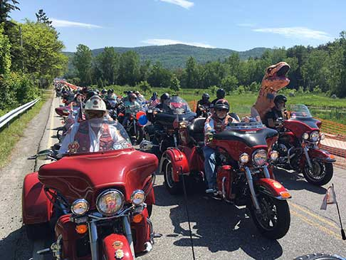 Hundreds of bikers riding side-by-side on the Adventurer Tour